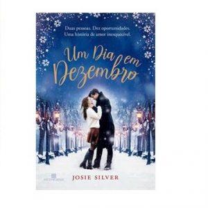 A foto mostra a capa do livro Um Dia em Dezembro: um casal em meio a um dia de neve.