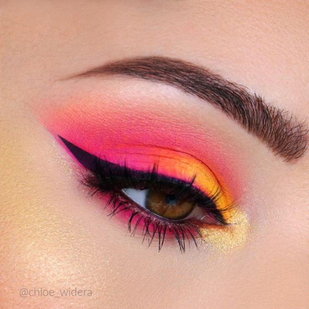 a foto mostra um olho com cores neon, uma das tendências de maquiagem